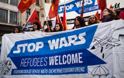 """Stop wars! Refugees welcome!"""