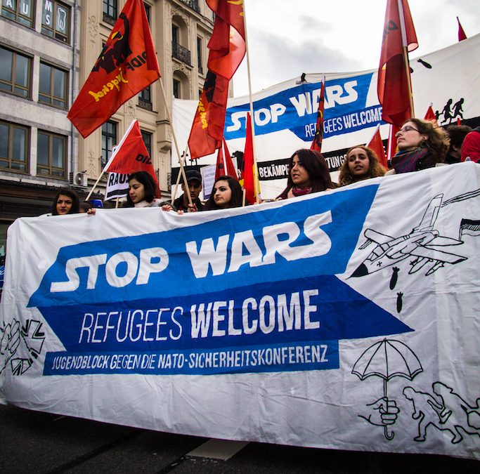 """""""Stop wars! Refugees welcome!"""""""
